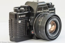 Praktica B200 side view showing self timer, depth of field preview and lens release