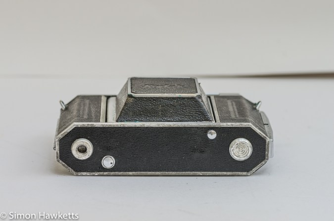 Kodak Retina IIa 35mm rangefinder camera bottom view showing the rewind button, the lens release button and the tripod bush