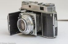 Kodak Retina IIa 35mm rangefinder camera side view showing the focus control and speed settings