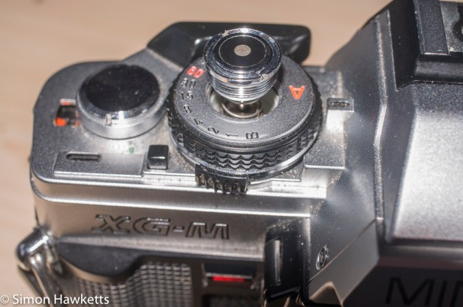 Minolta XG-M repair - caution, the button is spring loaded