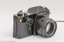 Ricoh Singlex TLS 35mm single lens reflex camera side view showing shutter speed control and self timer