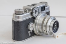 Argus C4 35mm rangefinder camera - side view showing shutter speed and focus adjuster