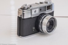 Yashica J 35mm rangefinder camera side view showing sync socket