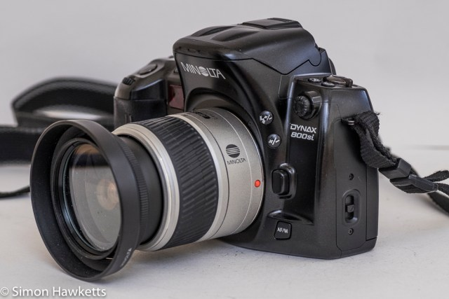 Minolta Dynax 800si autofocus 35mm camera - side view showing exposure comp, flash and lens release buttons