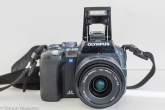 Olympus evoltE500 dslr - front view with flash raised