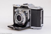 Zeiss Ikon Contina I 35mm viewfinder folding camera - side view showing self timer and flash sync