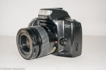 Minolta Dynax 300si 35mm autofocus camera - side view showing af/mf switch and lens release