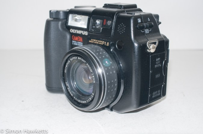 Olympus Camedia C-5050 digital camera - side view showing connection doors
