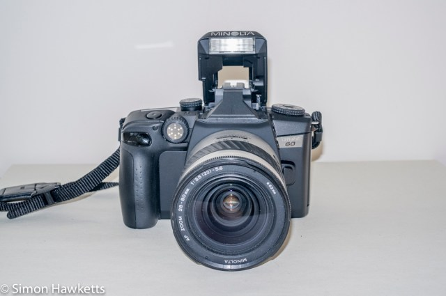 Minolta Dynax 60 SLR - Front view with flash raised