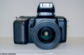 Nikon F-601 autofocus SLR - Front view with flash up