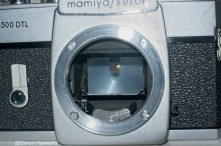 Mamiya/Sekor 500 DTL 35mm SLR camera - Front view showing mirror and Spot Meter sensor