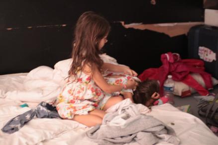 Dalia doing up Poppy's dress