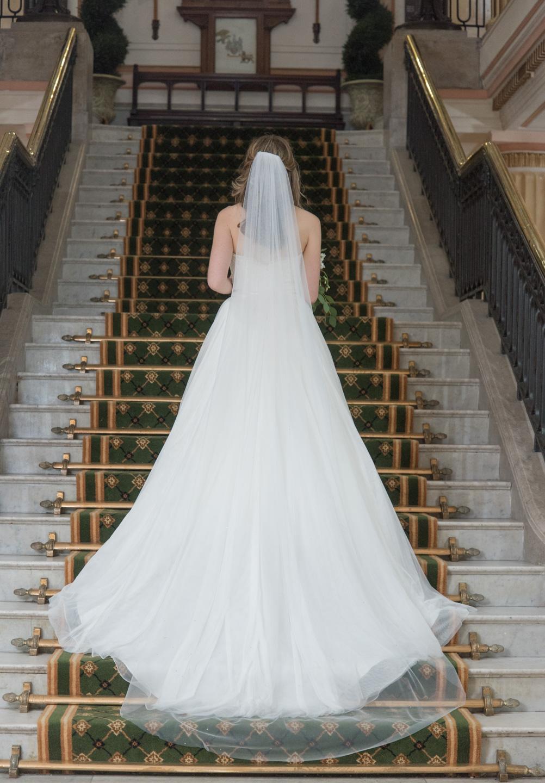 Back of wedding dress showing trail