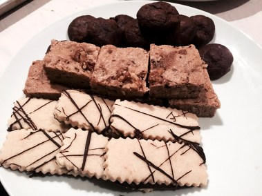 Assorted fresh desserts - chocolate cupcakes, brownies and shortbread