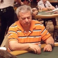 This is a picture of Archie Karas playing poker - he allegedly defeated professional poker players with the use of angle shooting techniques. You can read about his life, cheating, and significance in the poker scene to the right of the picture.