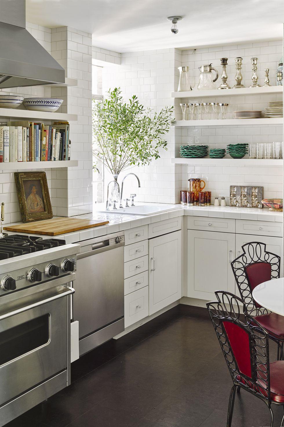 asko dishwasher, cork flooring, french garden chairs, viking range, small kitchen