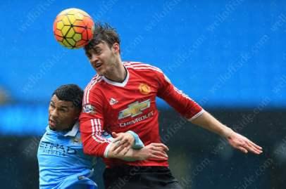 Will Keane of Man Utd U21 battles with Ellis Plummer of Man City U21