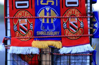 Souvenir scarves for sale ahead of the FA Cup 5th Round tie between Shrewsbury Town and Man Utd