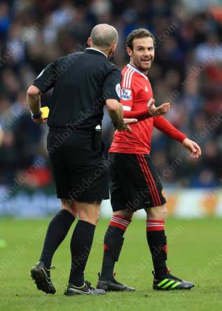 Juan Mata of Man Utd can't believe referee Mike Dean has sent him off in their match against West Brom