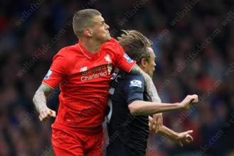 Martin Skrtel of Liverpool battles with Peter Crouch of Stoke