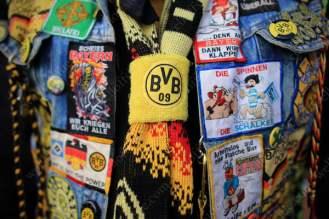 A Borussia Dortmund fan shows off his colours
