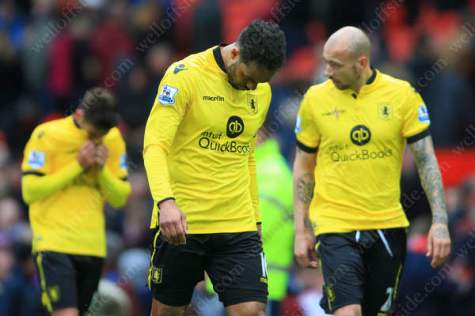 Joleon Lescott of Villa looks dejected following his side's defeat and consequent relegation from the Premier League