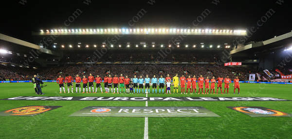 Liverpool and Man Utd players line up prior to their UEFA Europa League clash at Anfield