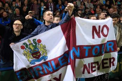 Burley fans cheer on their side against rivals Preston North End