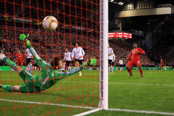 Daniel Sturridge of Liverpool scores their 1st goal against Man Utd in the UEFA Europa League with a penalty