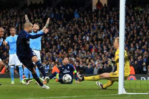 Man City goalkeeper Joe Hart saves at point blank range from Pepe of Madrid