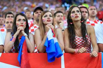 A trio of Croatian fans watch nervously as the game gets under way