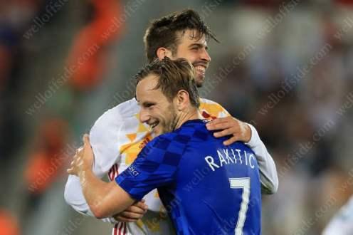 FC Barcelona teammates Gerard Pique of Spain (L) and Ivan Rakitic of Croatia share a joke
