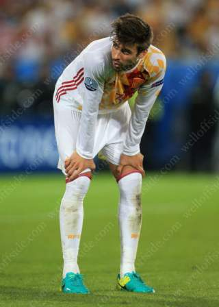 Gerard Pique of Spain looks dejected