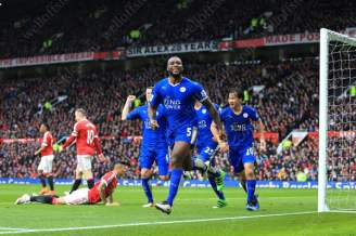 Wes Morgan of Leicester celebrates after scoring their 1st goal against Manchester United