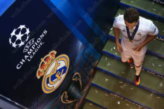 Cristiano Ronaldo of Real walks down the steps to the dressing room after the game
