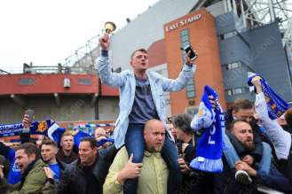 Leicester fans celebrate after another point took them within touching distance of the Barclays Premier League title
