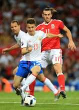 Aleksandr Golovin of Russia battles with Gareth Bale of Wales