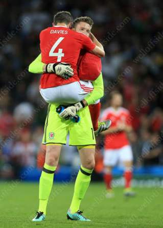 Ben Davies and Wales goalkeeper Wayne Hennessey celebrate victory
