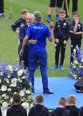 Leicester manager Claudio Ranieri stands alongside classical tenor singer Andrea Bocelli as he performs on stage before the match