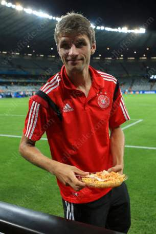 Thomas Muller enjoys a bowl of pasta after the 2014 FIFA World Cup Semi Final
