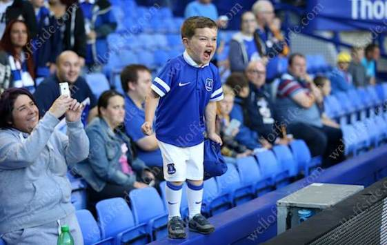 A young Everton fan screams from the sidelines
