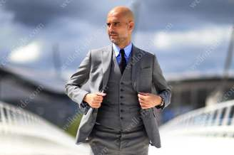 New Man City manager Pep Guardiola oozes style during his unveiling