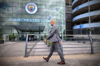 New Man City manager Pep Guardiola arrives at the Etihad Stadium