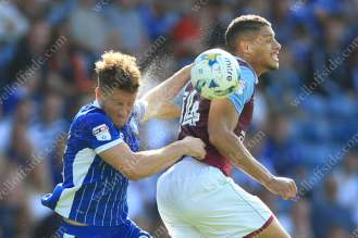 Rudy Gestede of Villa battles with Sam Hutchinson of Sheff Wed