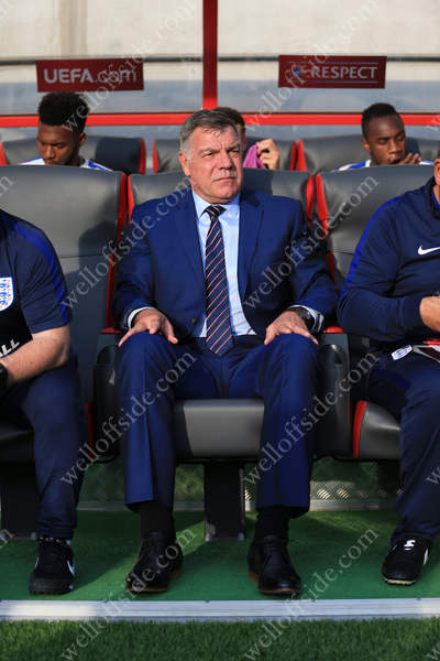New England manager Sam Allardyce takes his seat in the dugout for his first match in charge