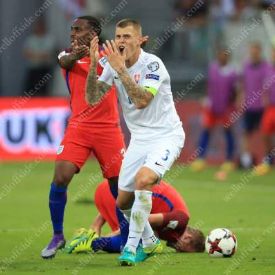 Martin Skrtel of Slovakia reacts after being sent off for his challenge on England's Harry Kane
