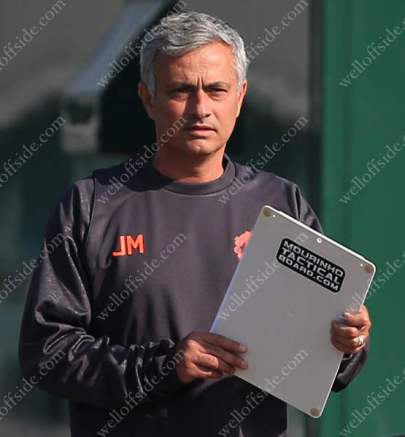 Man Utd manager Joe Mourinho carries a personalised tactics board