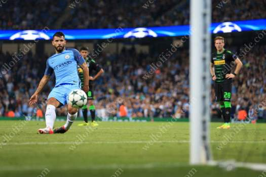 Sergio Aguero of Man City scores their 2nd goal with a penalty