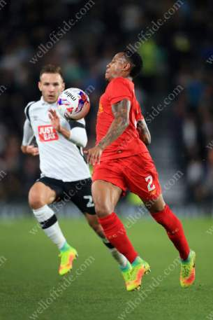 Nathaniel Clyne of Liverpool battles with Andreas Weimann of Derby