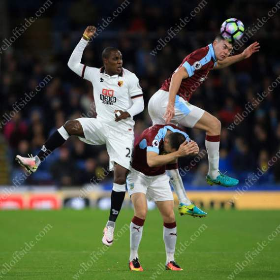 Odion Ighalo of Watford battles with Michael Keane of Burnley (R) and Dean Marney of Burnley (C)